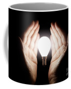 Hands Holding Light Bulb Coffee Mug