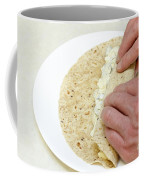 Hands Wrapping Egg Salad Wrap Coffee Mug