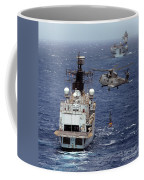 Hms Cornwall Is Pictured Receiving Stores By Merlin Helicopter  Coffee Mug