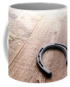 Horseshoe On Wood Floor Coffee Mug