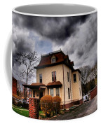 House With Storm Approaching Coffee Mug