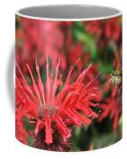 Hummingbird Moth Feeding On Red Flower Coffee Mug