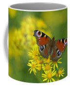 Inachis Io Butterfly On The Yellow Flowers Coffee Mug