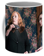 Inside A House, Two Women Stand Looking Coffee Mug