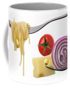 Italian Food Ingredients On Forks Against White Coffee Mug