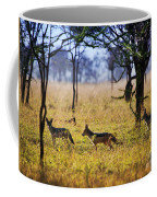 Jackals On Savanna. Safari In Serengeti. Tanzania. Africa Coffee Mug