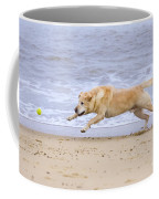 Labrador Dog Chasing Ball On Beach Coffee Mug
