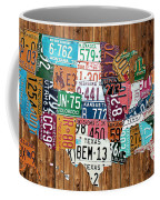 License Plate Map Of The United States - Warm Colors On Pine Board Coffee Mug by Design Turnpike
