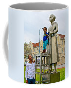 Little Girl Gets Close To Woman Sculpture In Donkin Reserve In Port Elizabeth-south Africa Coffee Mug