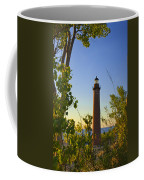 Little Sable Lighthouse Seen Through The Trees Coffee Mug