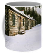 Log Cabins In Fort Wilkins Coffee Mug
