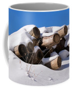 Log Pile In A Snow Drift In Winter Coffee Mug