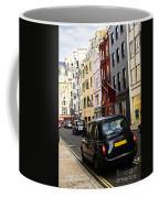 London Taxi On Shopping Street Coffee Mug by Elena Elisseeva