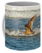 Long-billed Curlew Flying Over The Surf Coffee Mug