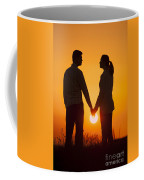 Lovers Holding Hands At Sunset In Silhouette Coffee Mug