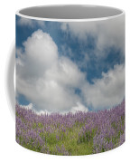 Lupine Field Under Clouds Coffee Mug