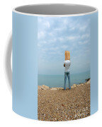 Man By The Sea With Bag On His Head Coffee Mug