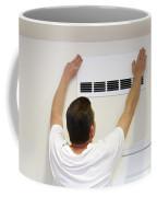 Man Covering Air Vent Coffee Mug