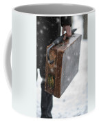 Man Holding A Vintage Leather Suitcase In Winter Snow Coffee Mug