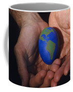 Man Holding Earth Egg Coffee Mug by Jim Corwin
