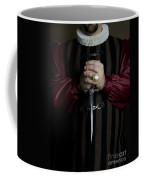 Man In Baroque Outfits Holding A Silver Dagger Coffee Mug