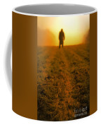 Man In Field At Sunset Coffee Mug
