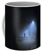 Man In Hat And Overcoat Walking In Fog On A Tree Lined Avenue In Coffee Mug