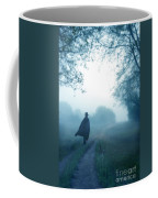 Man In Top Hat And Cape On Foggy Dirt Road Coffee Mug