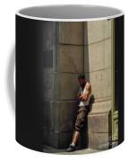 Man Leaning Against Wall In Sun Coffee Mug