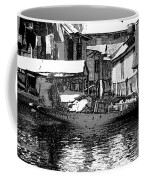 Man Plying A Small Boat Laden With Vegetables In The Dal Lake Coffee Mug