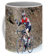 Man Riding Bike In A Race Coffee Mug by Susan Leggett