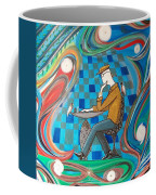 Man Sitting In Chair Contemplating Chess With A Bird Coffee Mug