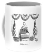 Man Stands Speaking At Podium With A Sign Coffee Mug