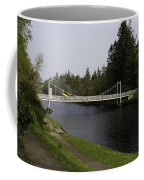 Man With Kayak Crossing Over Small Bridge From Ness Islands Coffee Mug
