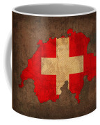 Map Of Switzerland With Flag Art On Distressed Worn Canvas Coffee Mug by Design Turnpike