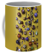 Marbles On Yellow Wooden Table Coffee Mug