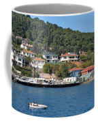 Marina Bay Scene With Boat And Houses On Hills Coffee Mug