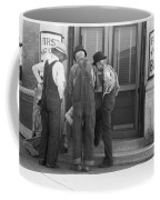 Men Talking On Bank Steps Coffee Mug