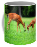 Mom Sharing A Snack With Her Baby Fawn Coffee Mug