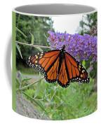 Monarch Under Flowers Coffee Mug