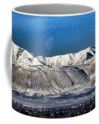 Moon Over The Snow Covered Mountains Coffee Mug