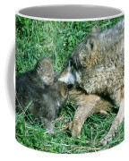 Mother Wolf Nuzzles Cubs Coffee Mug