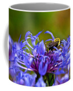 Mountain Cornflower And Bumble Bee Coffee Mug by Byron Varvarigos