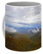 Mountain Seasons Coffee Mug by Susan Leggett