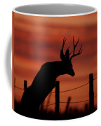 Mule Deer Buck Jumping Fence At Sunset Coffee Mug