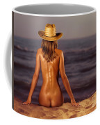 Naked Woman Sitting At The Beach On Sand Coffee Mug
