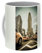 Nyc Yellow Cabs At The Flat Iron Building - V1 Coffee Mug by Hannes Cmarits