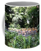 Oil Painting - A Number Of Flamingos Surrounded By Greenery In Their Enclosure  Coffee Mug
