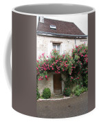 Old House Covered With Roses Coffee Mug