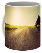 Old Man Riding A Bike To Sunny Sunset Sky Coffee Mug